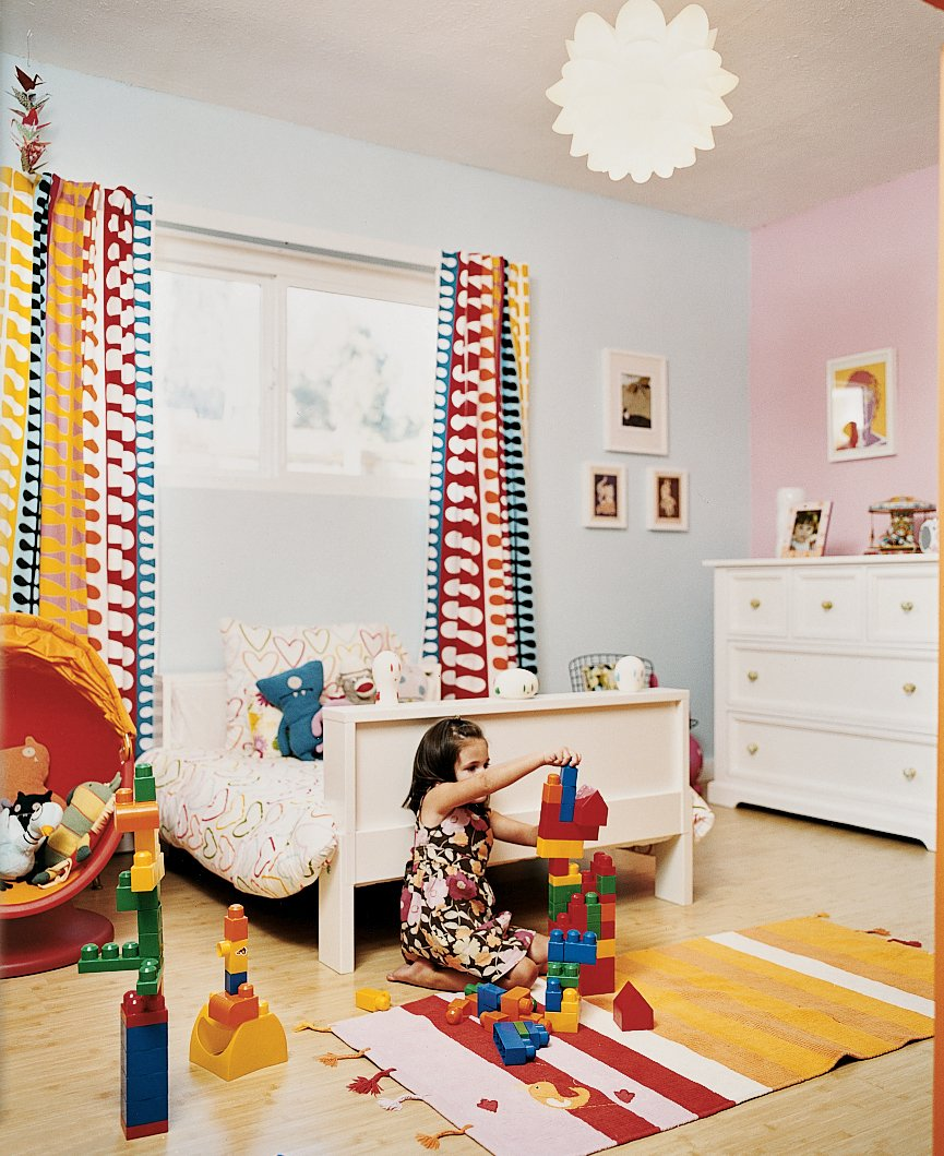 Kids Room and Bedroom Room Type Even in Ella's room, Ikea chairs and bed mingle with a restored Bertoia child's chair.  Photo 6 of 6 in Affordable Modern House Built with Sheer Determination