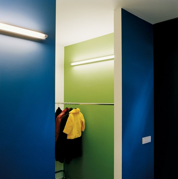 "Storage Room and Closet Storage Type Simple wall-mounted strip lighting, seen here in the cloakroom, is used throughout the house. ""The beauty is the light, not the fitting,"" explains Van Everbroeck.  Interior Inspiration: 5 Bold Ways to Use Color by Jaime Gillin from The Tree of Ghent"