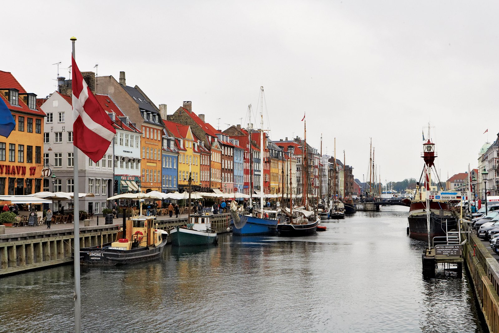 Once a red-light district and popular brawling spot for drunken sailors, today Nyhavn   is packed with restaurants and cafes, and is a starting point for canal boat tours.  Photo 2 of 10 in Copenhagen, Denmark