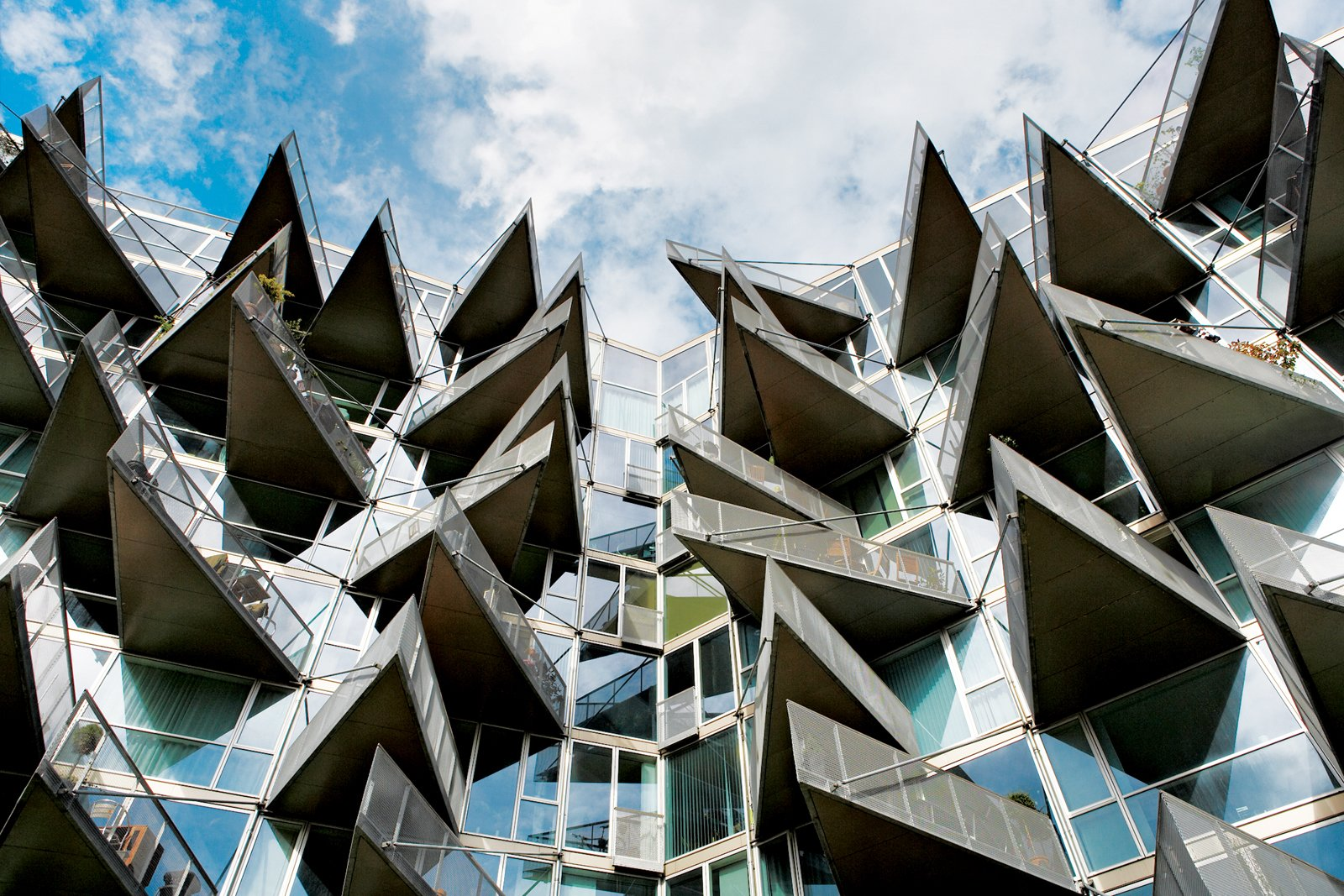 The 2005 VM apartment complex in the Ørestad district, designed by PLOT, takes its name from the shapes of the two plans: While the M balconies are flush with the building's facades, those covering the V structure jut ominously like shark's teeth.  Photo 4 of 10 in Copenhagen, Denmark