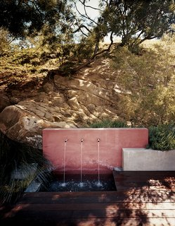 An outdoor water feature adds a subtle soundtrack to the property while keeping the plants irrigated.