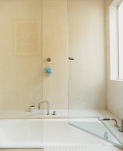 The bathroom includes a walk-in tub.