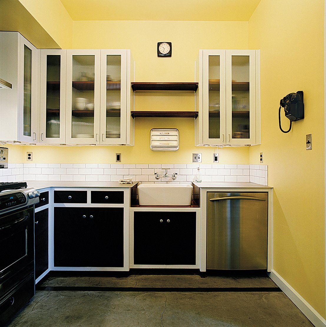 Kitchen and Dishwasher Almost every element of the interior—from the kitchen cabinetry to the art on the walls—was created by Dollahite himself.  Photo 3 of 10 in Salvage Love