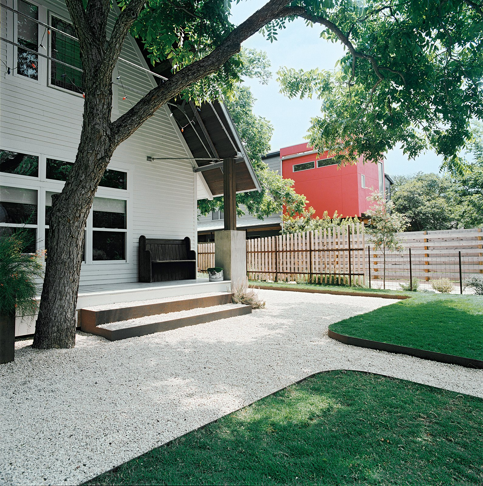 Outdoor, Grass, and Walkways Dollahite's house sits on a tree-lined block in the north Austin neighborhood of Hyde Park. His remodel retained the old Texas feel of the exterior, with modern touches inside.  12 Porches Across America by Diana Budds from Salvage Love