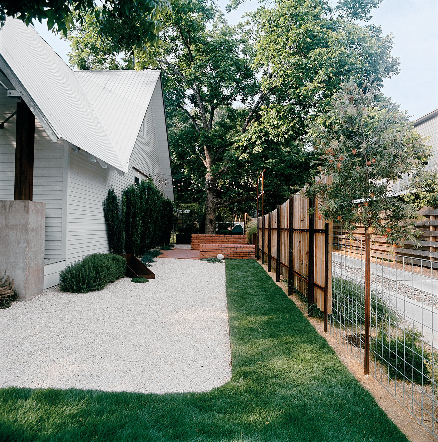 Outdoor, Walkways, and Grass Patches of sod amid white gravel keep water needs low.  Photo 10 of 10 in Salvage Love