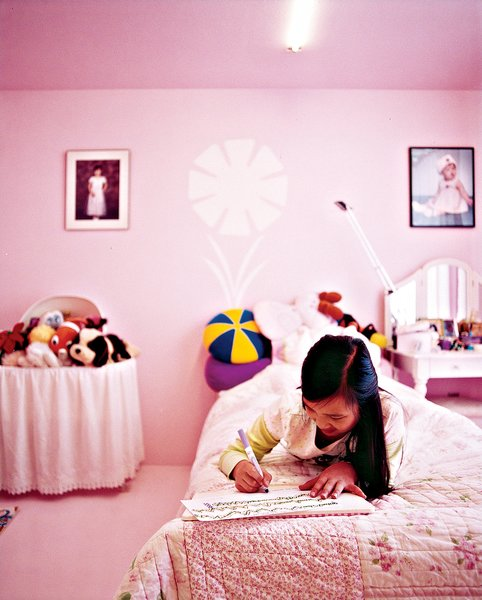 """Inside, the space is spare but infused with color because """"painting is the cheapest way to decorate."""" Twelve-year-old Tabitha's room is pink."""