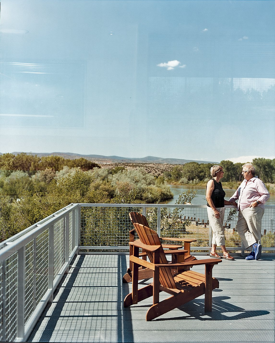 The rooftop is wired for a solar farm, but they are waiting for better prices and tax breaks before investing. Tagged: Outdoor, Rooftop, Wood Patio, Porch, Deck, and Metal Fences, Wall.  Photo 10 of 10 in Abiquiu Debut