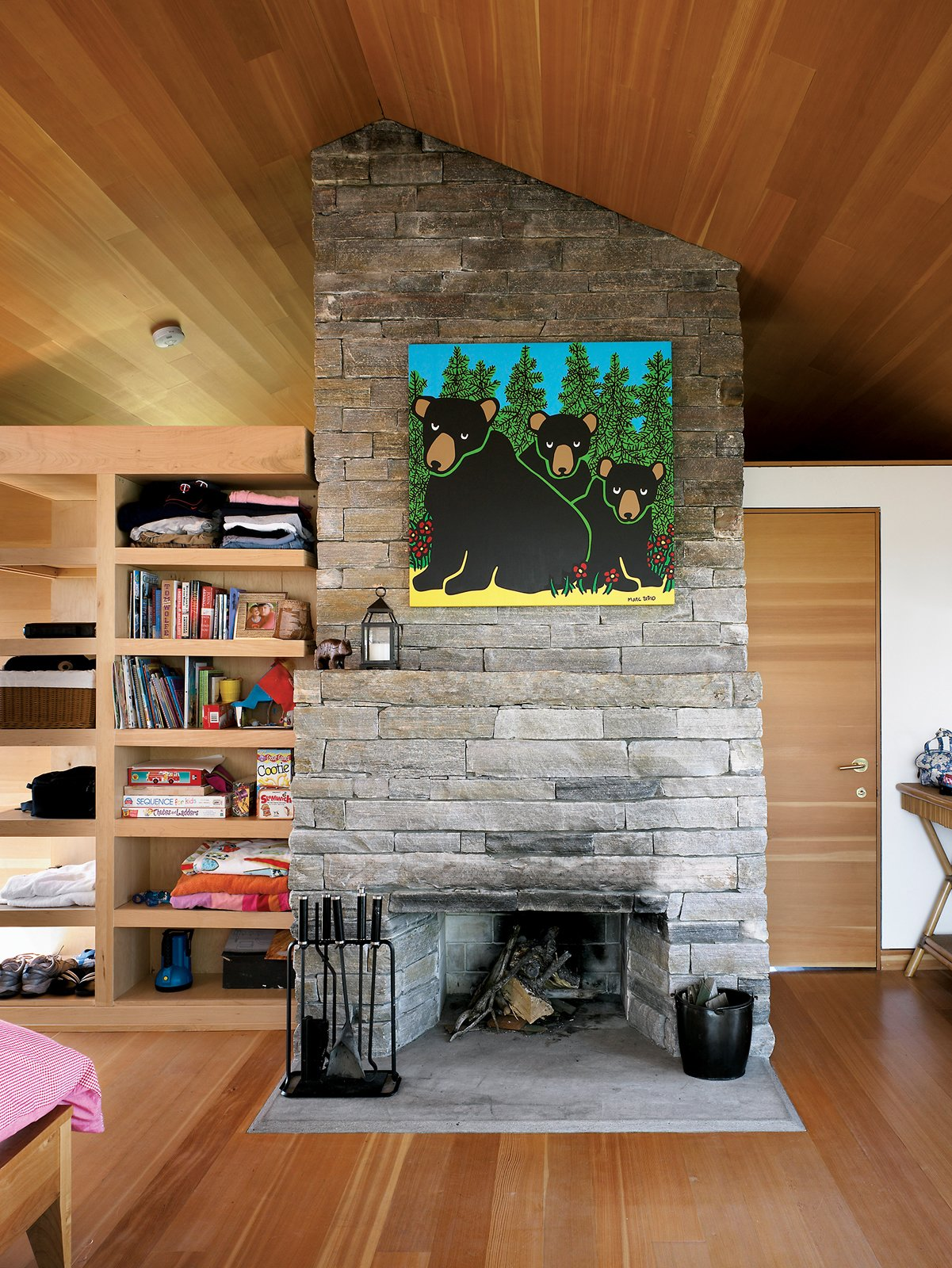 Living Room, Standard Layout Fireplace, and Medium Hardwood Floor Inside the sleeping cabin, a fireplace built of local granite marks the midpoint between two bedrooms and a bathroom.  Photo 3 of 16 in Floating House, Lake Huron