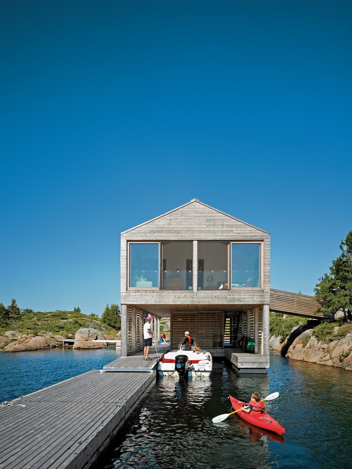 Outdoor, Wood Patio, Porch, Deck, and Decking Patio, Porch, Deck All of the Worples' guests arrive by boat to the lower level of the Floating House.  Photo 6 of 16 in Floating House, Lake Huron