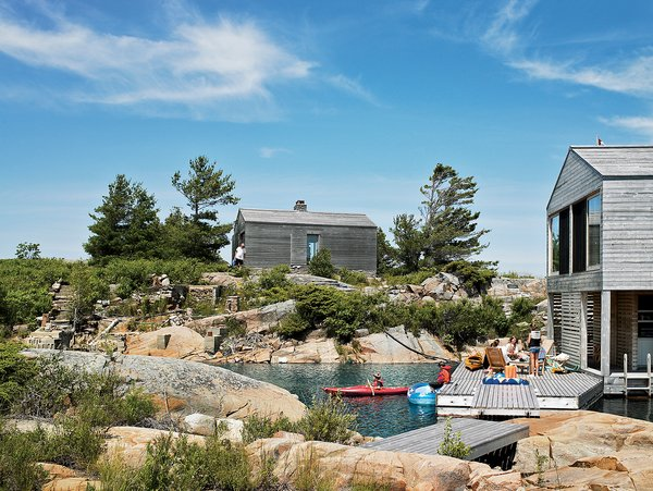 The sleeping cabin perches on a rocky rise near the Floating House; Meredith imagines these two as a start of a string of buildings that will wrap around the island.