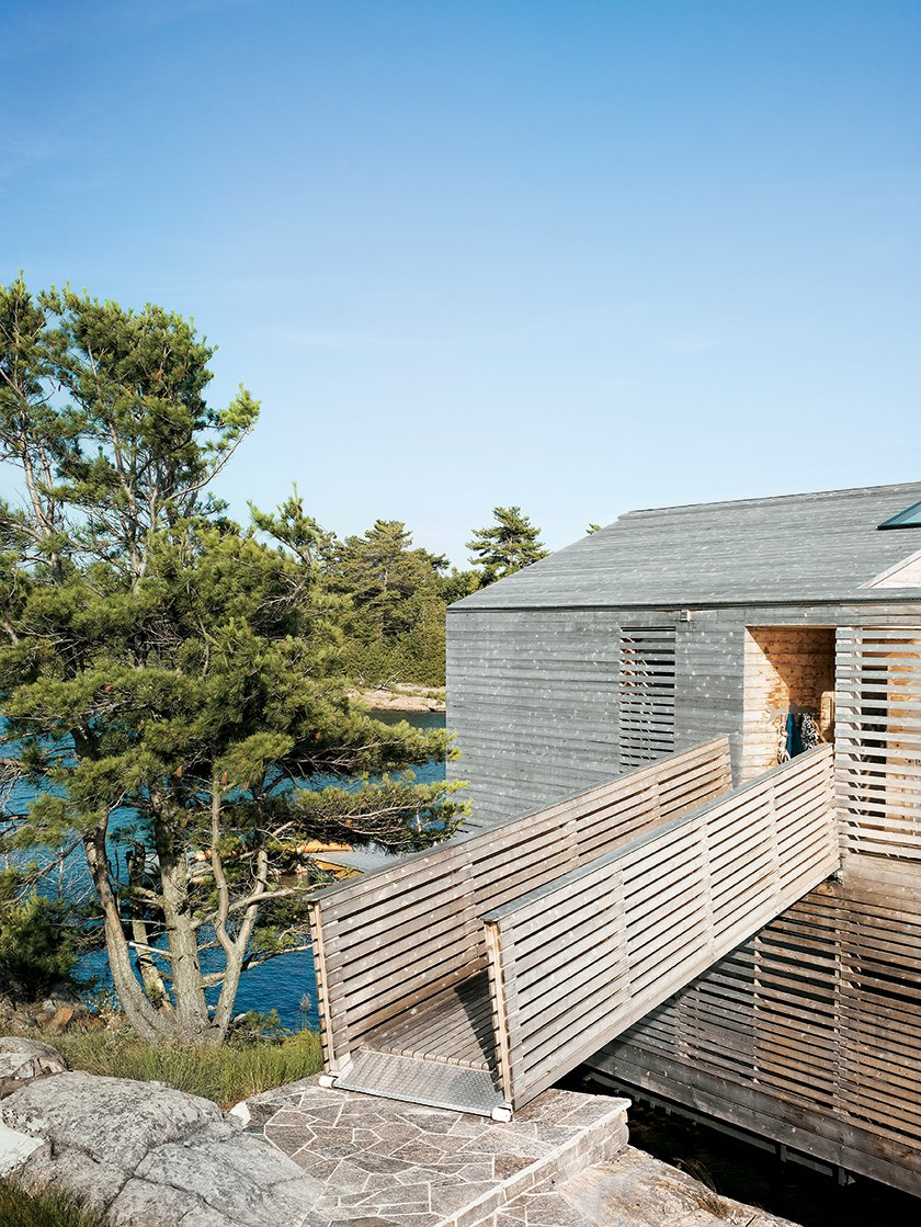 Exterior, Wood Siding Material, and House Building Type A footbridge connects the Floating House to the island.  Cabins & Hideouts from Floating House, Lake Huron
