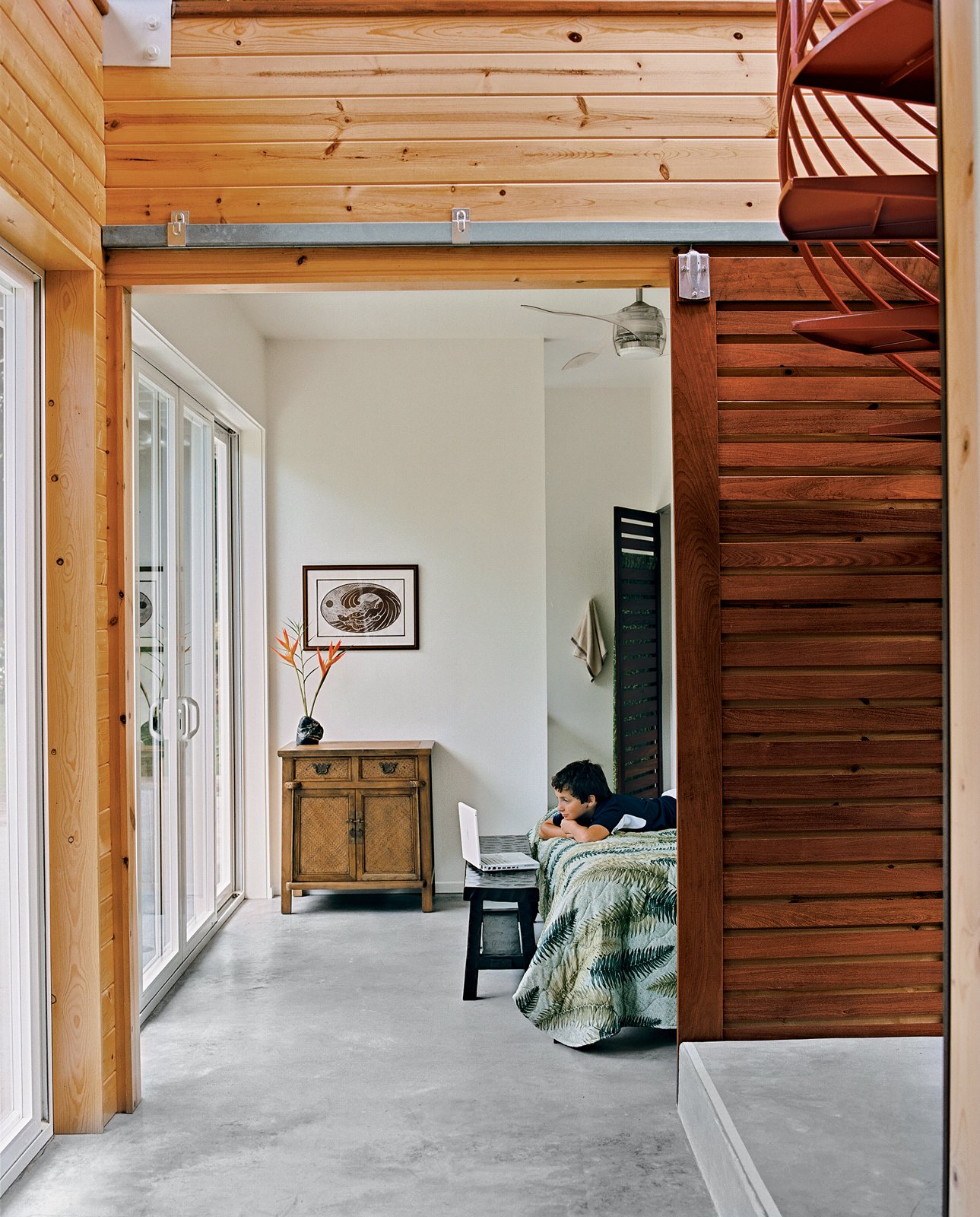 Kids Room Kurokawa and Fishman's son Danny Fishman-Engel enjoys time away from the city by studying magic tricks in his bedroom. Sliding slatted doors separate the asymmetrical downstairs spaces.  Photo 9 of 9 in Lava Flow 4, The Big Island