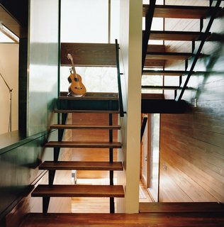 The stairway to the office loft is lit by translucent windows insulated with Nanogel.