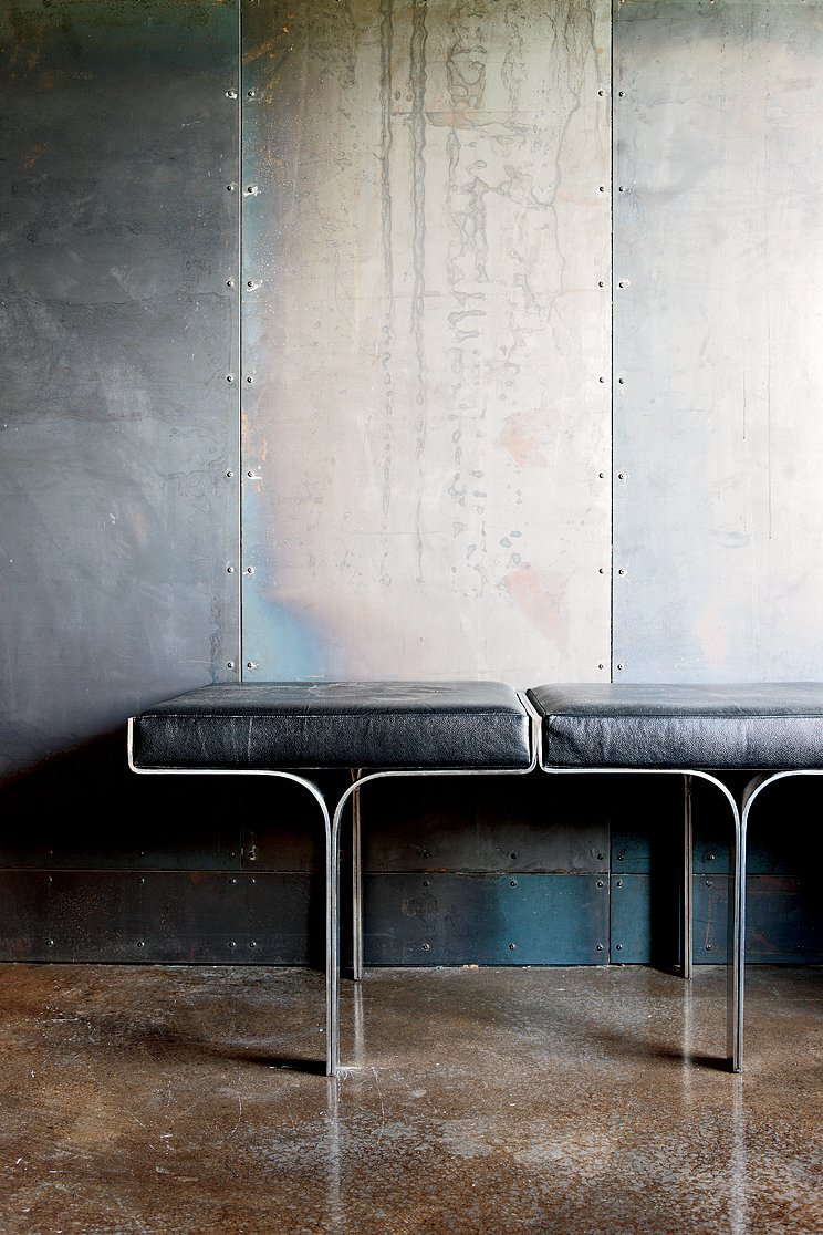 Living Room and Bench An aluminum bench harmonizes with the industrial nature of the galvanized-steel walls and the polished concrete floor.  Photo 3 of 8 in Scrap House
