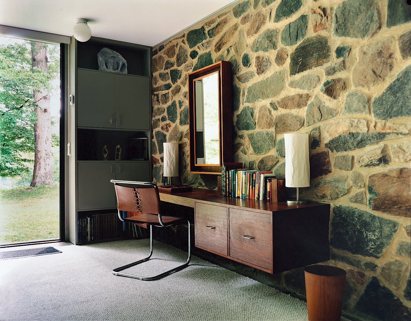 Office, Desk, Chair, Lamps, and Rug Floor Although the house was refurbished before North bought it in 1996, it still includes some of Breuer's original built-in furniture, including the desk in the bedroom, as well as a chair designed by the architect.  Photo 5 of 9 in Marcel Breuer Hooper House II