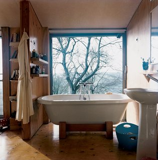 In the master bathroom upstairs, the Tokyo roll-top bathtub from victoriaplumb benefits from an epic view.