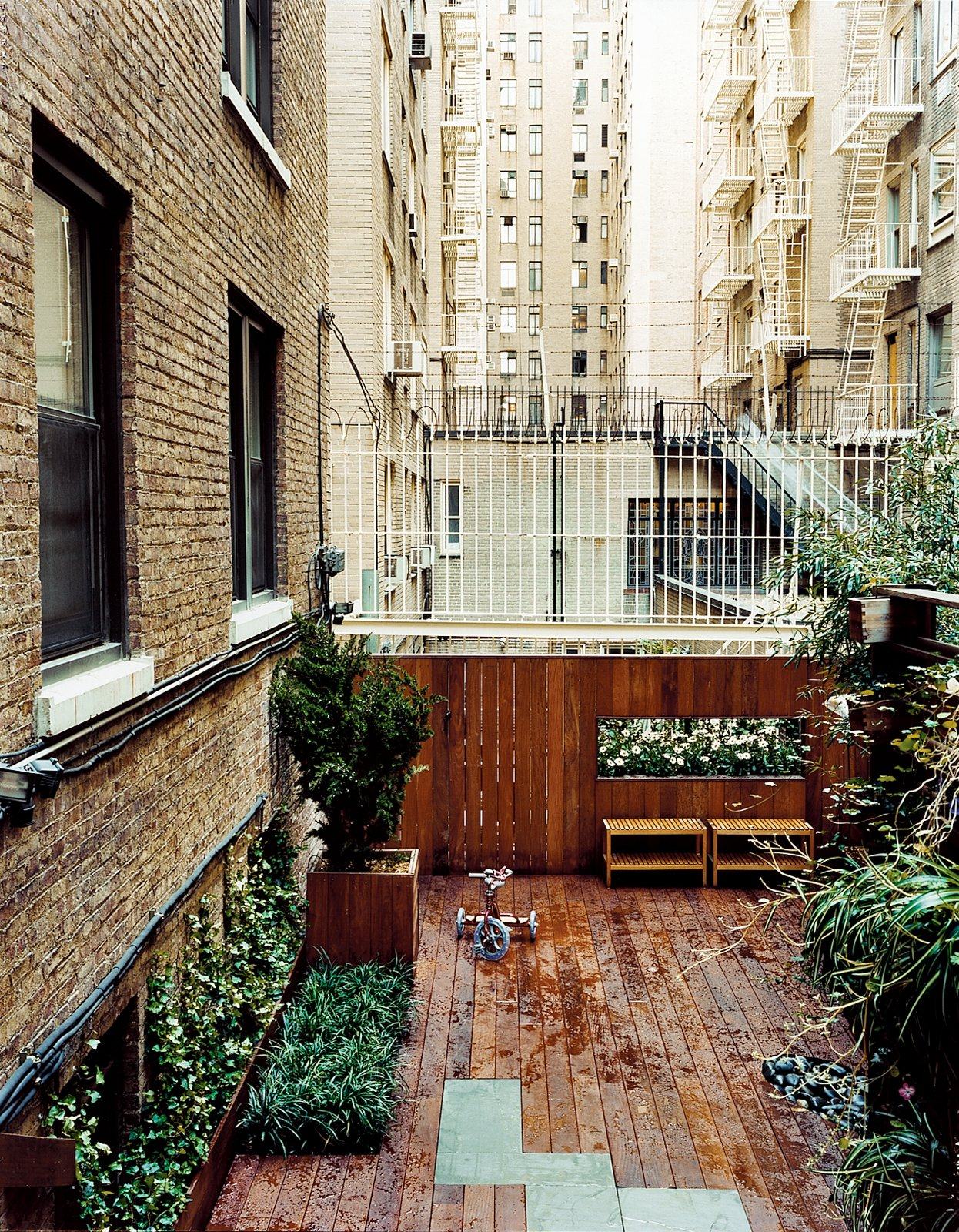 The Zizmors installed a 16-foot-wide deck for playing and grilling, and lined it with hostas, Hollywood juniper, and bamboo.  Photo 5 of 11 in Outdoor Living in NYC