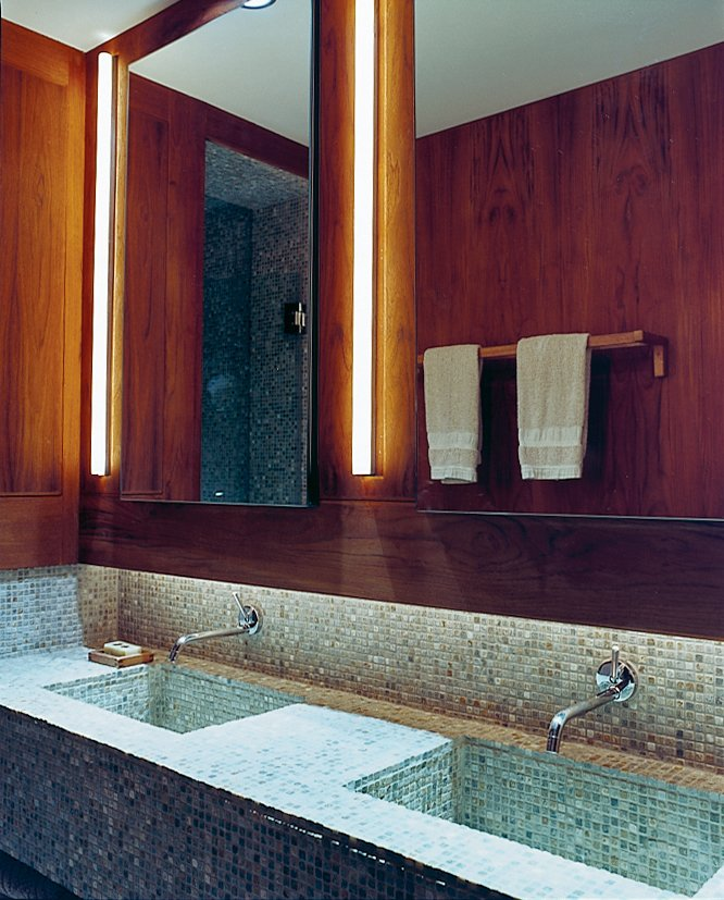 Humble materials are used to good effect throughout the apartment. The bathroom contains ordinary rope lights concealed above the sinks. The tumbled slate mosaic tiles are by Artistic tile. All the wooden bathroom accessories were purchased from Ikea.  Photo 7 of 11 in Outdoor Living in NYC