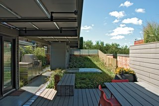 A rainwater catching system irrigates the rooftop garden, which also has a dining area and grill.