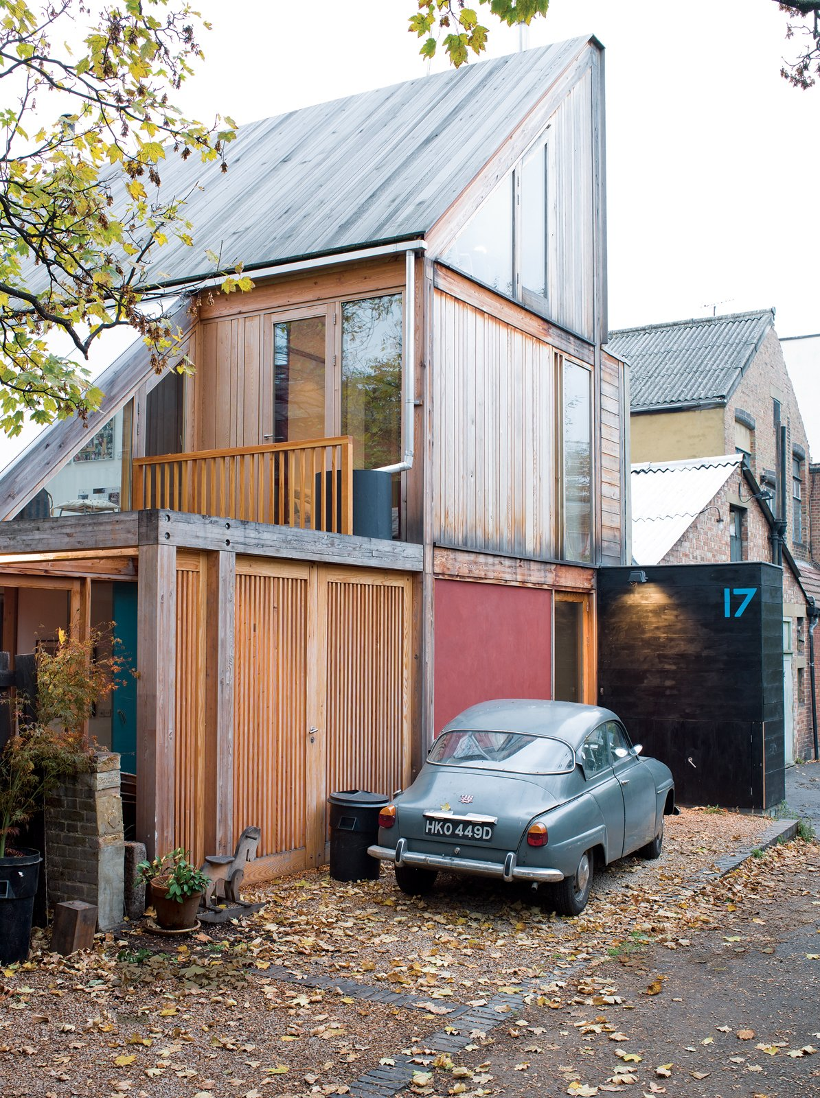 Exterior and Wood Siding Material Marcus Lee and Rachel Hart's wonderful wooden home sits at the end of a quiet London lane and politely turns its back on the workshops next door.  Photo 1 of 8 in Slanted and Enchanted