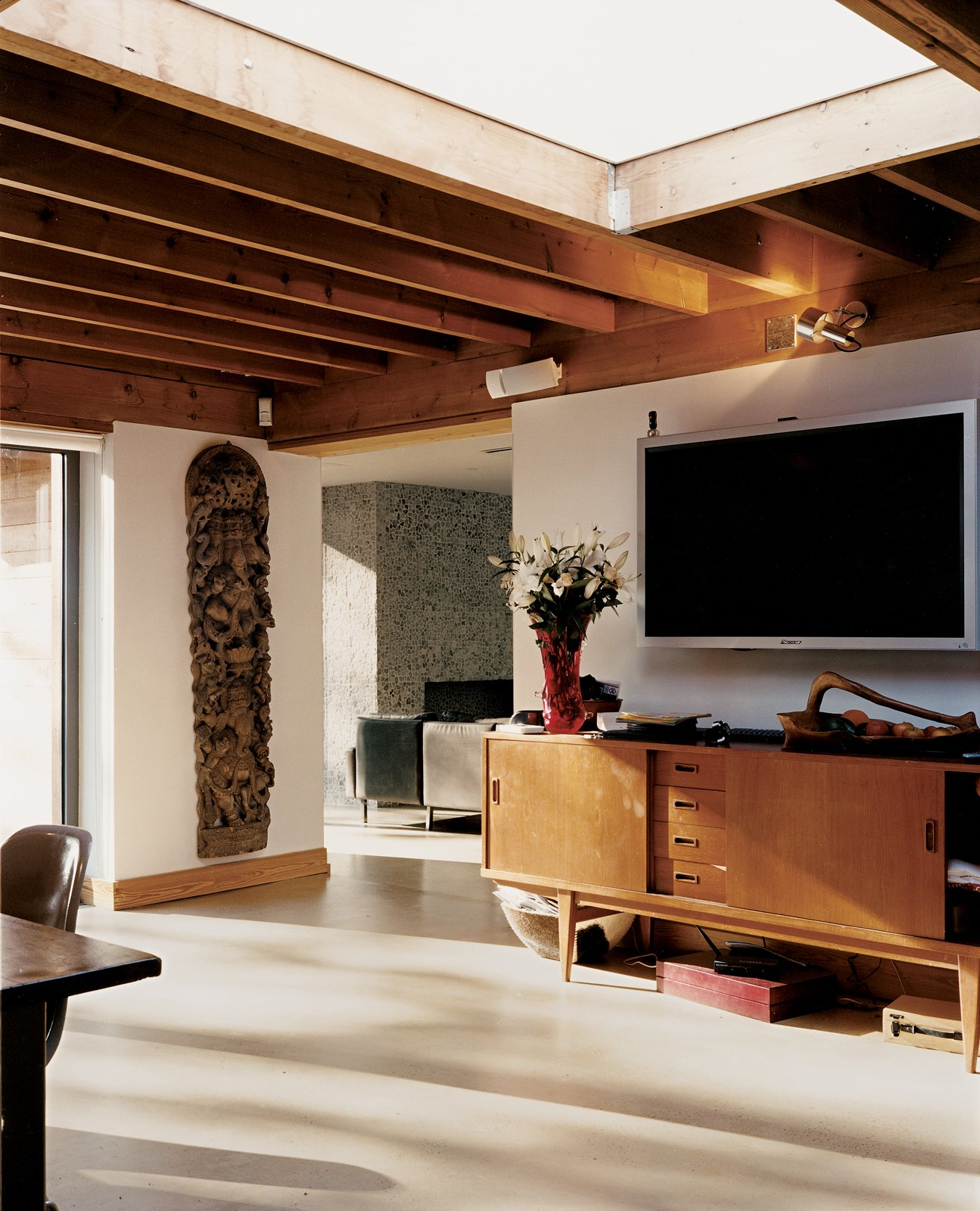 Living Room An expansive skylight gives a feeling of spaciousness to the kitchen/dining area.  Photo 6 of 7 in Heart of the Country