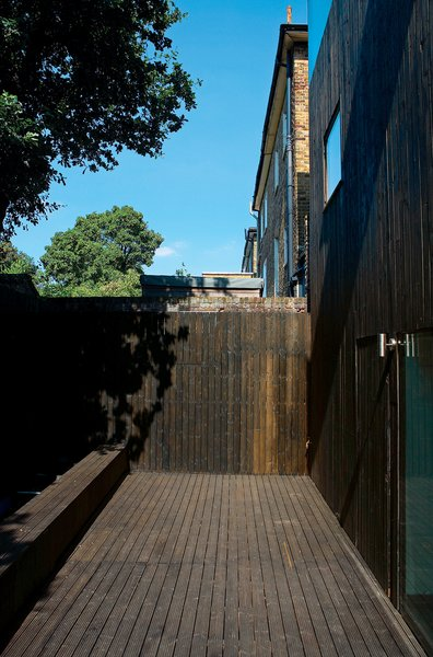 Even the rear facade is seamless—its door all but disappearing into the cedar cladding.