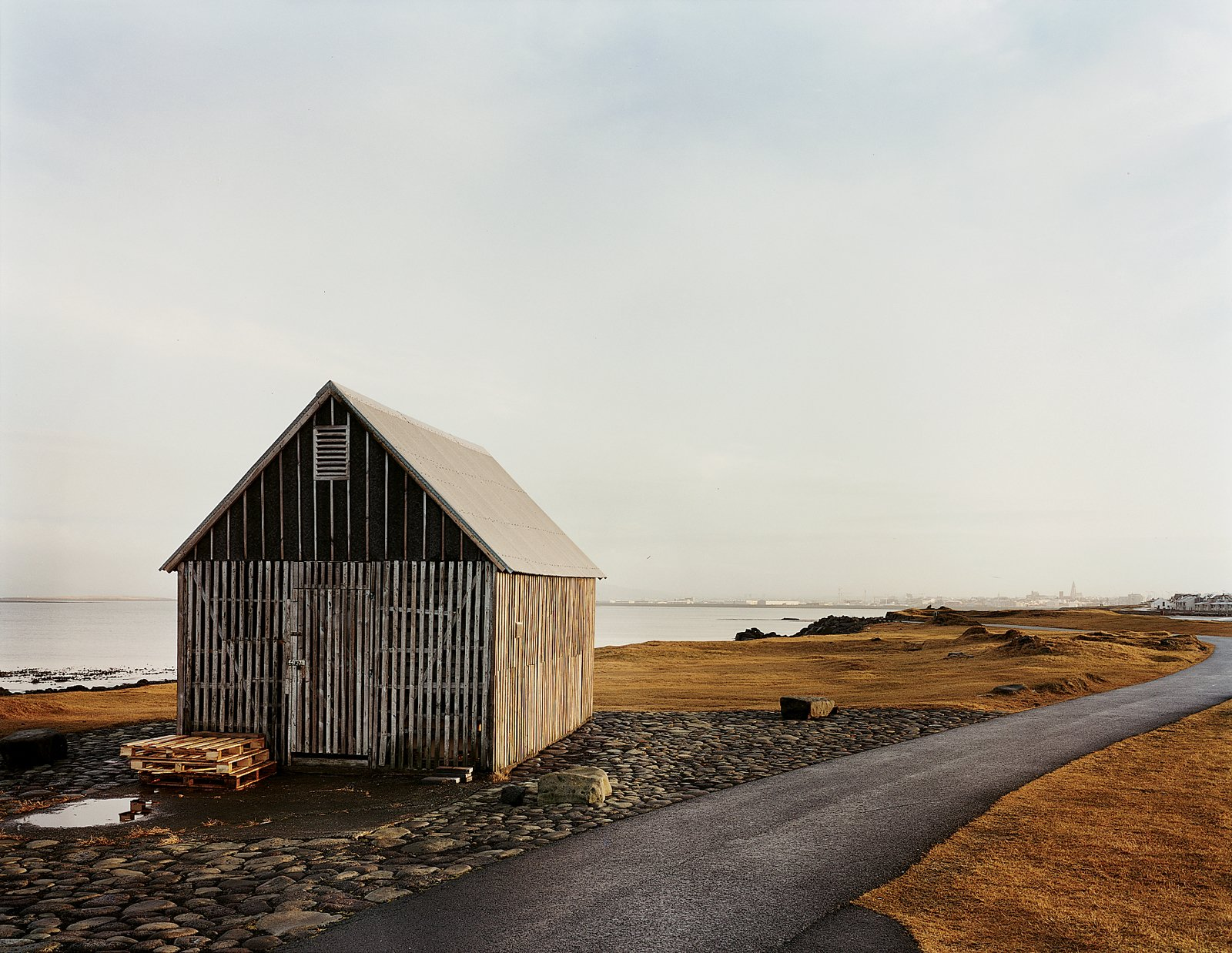 Exterior, Cabin Building Type, Wood Siding Material, Gable RoofLine, and Metal Roof Material A shark-skinning shack.  Photo 93 of 101 in 101 Best Modern Cabins from Reykjavík, Iceland