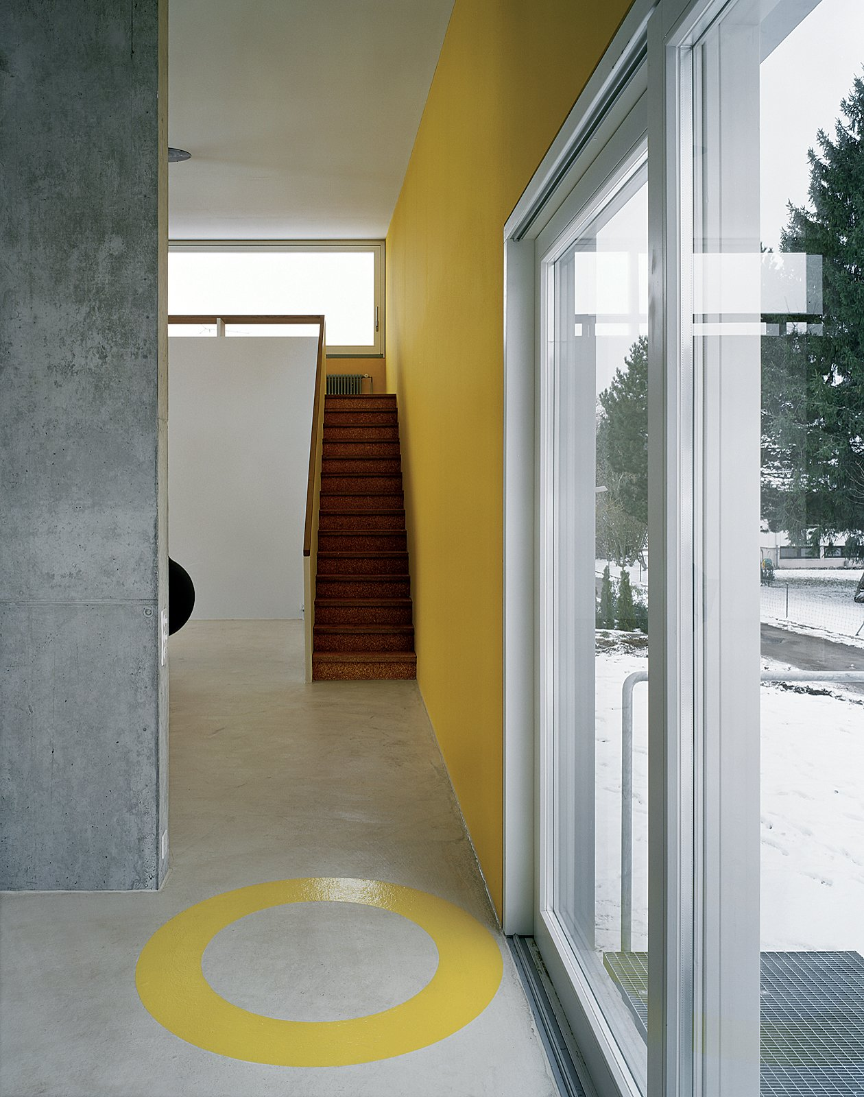 Upstairs, gallery windows frame the Rhine River. A concrete core (visible on the left) houses the kitchen, the bathroom, and a mini wine cellar below.  Photo 3 of 3 in Straw Tech