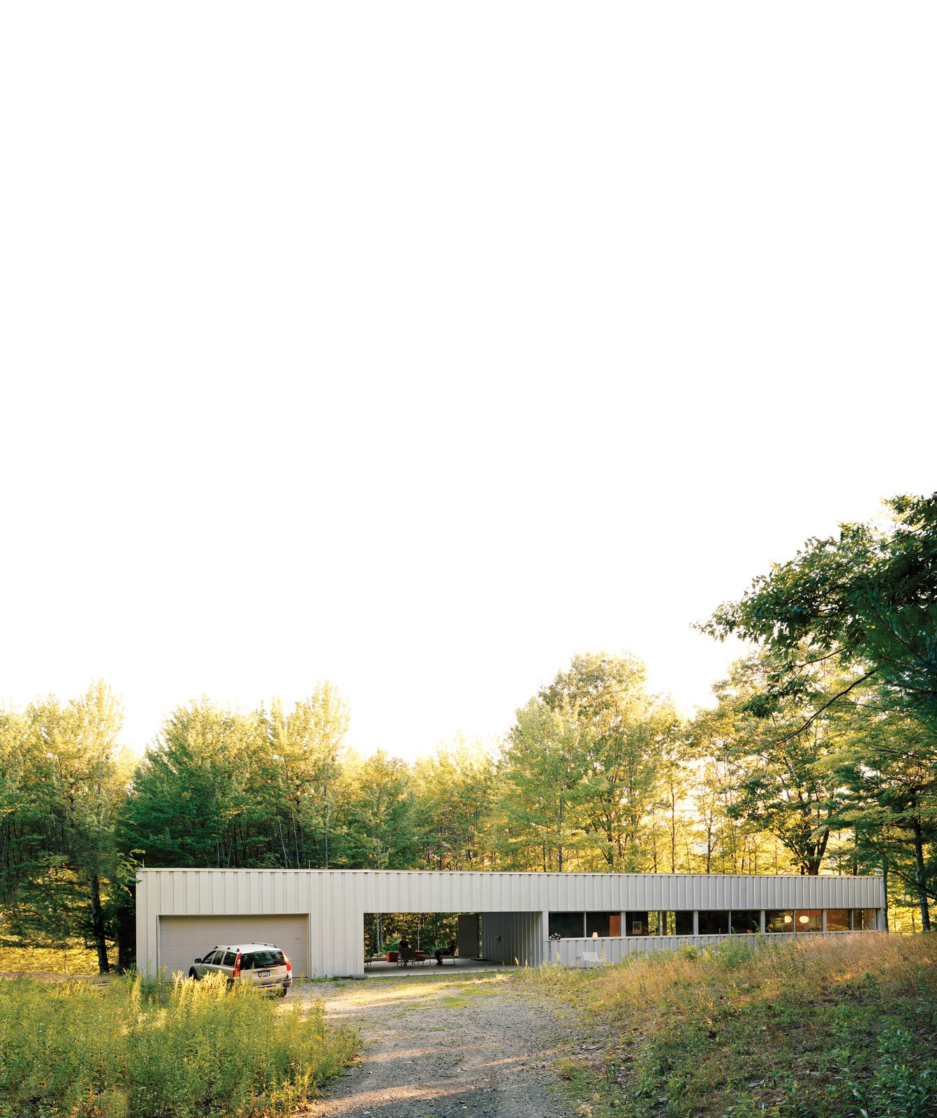 Exterior, House Building Type, Metal Roof Material, and Metal Siding Material This steel-and-glass house, set amid dense forest south of Ithaca, New York, captivated Maria Cook and Lance Compa when they first toured it in 2004. They bought it not long afterward and turned it into a weekend retreat.  Photos from Industrial Revolution