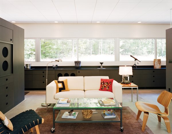 The house has become a showcase for Cook and Compa's collection of modern furniture, including several Eames chairs and a Jens Risom chair for Knoll.