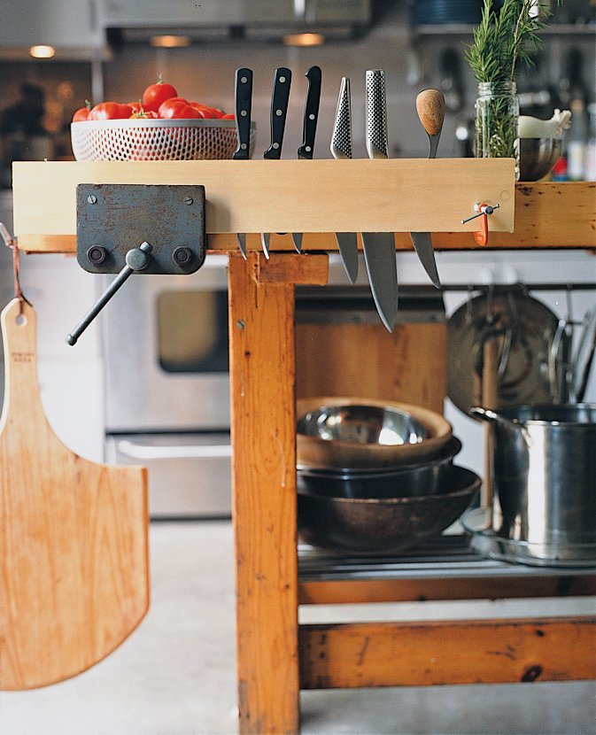 """Summit created a functional kitchen island out of Walz's childhood workbench, fitting   it with various IKEA parts. The vice makes an ideal wine grabber, and pieces of black iron pipe hold candles. """"Now it's very Martha Stewart,"""" jokes Summit.  Photo 1 of 5 in Pittsburgh Steeler"""