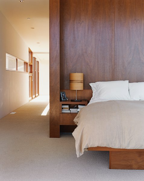 The master bedroom interior is finished with cherry wood.