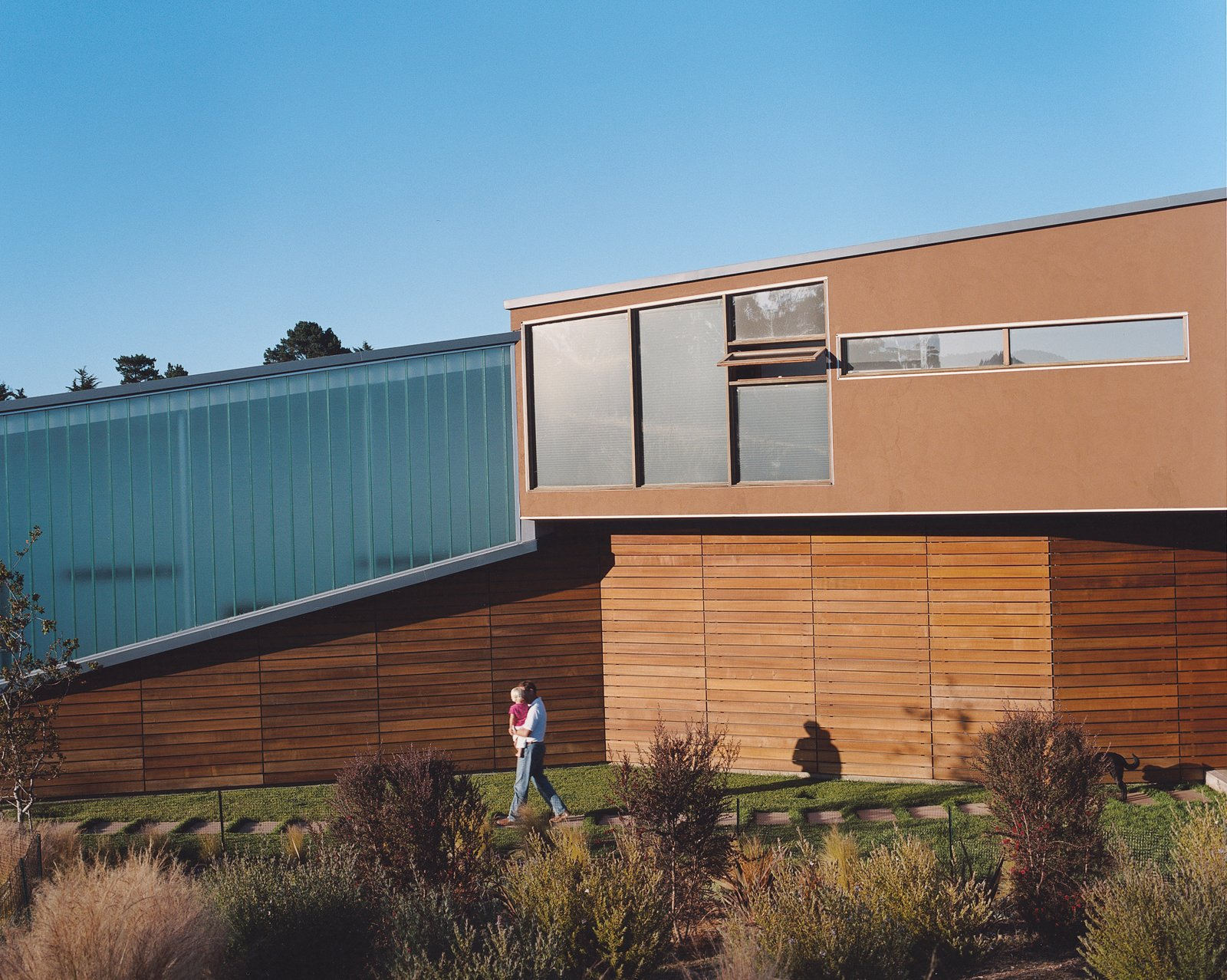 The Shermans' home is designed to blend effortlessly with the hillside on which it rests by using a muted material palette of troweled plaster and cedar planking.  Photo 5 of 5 in Untraditional in Marin