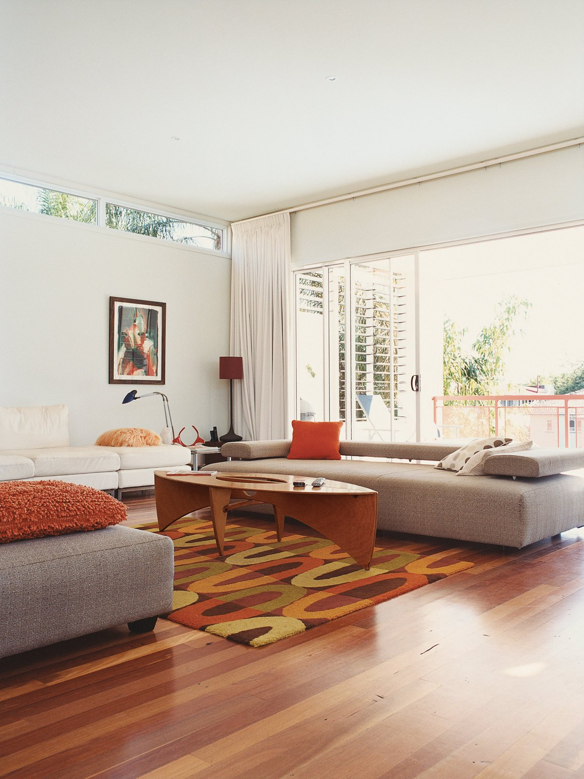 "Medium Hardwood Floor and Coffee Tables The low-slung Strata sofa by King Furniture is perfect for ""sleeping.""  Photo 2 of 8 in Minimalist Bachelor Pad in Brisbane"