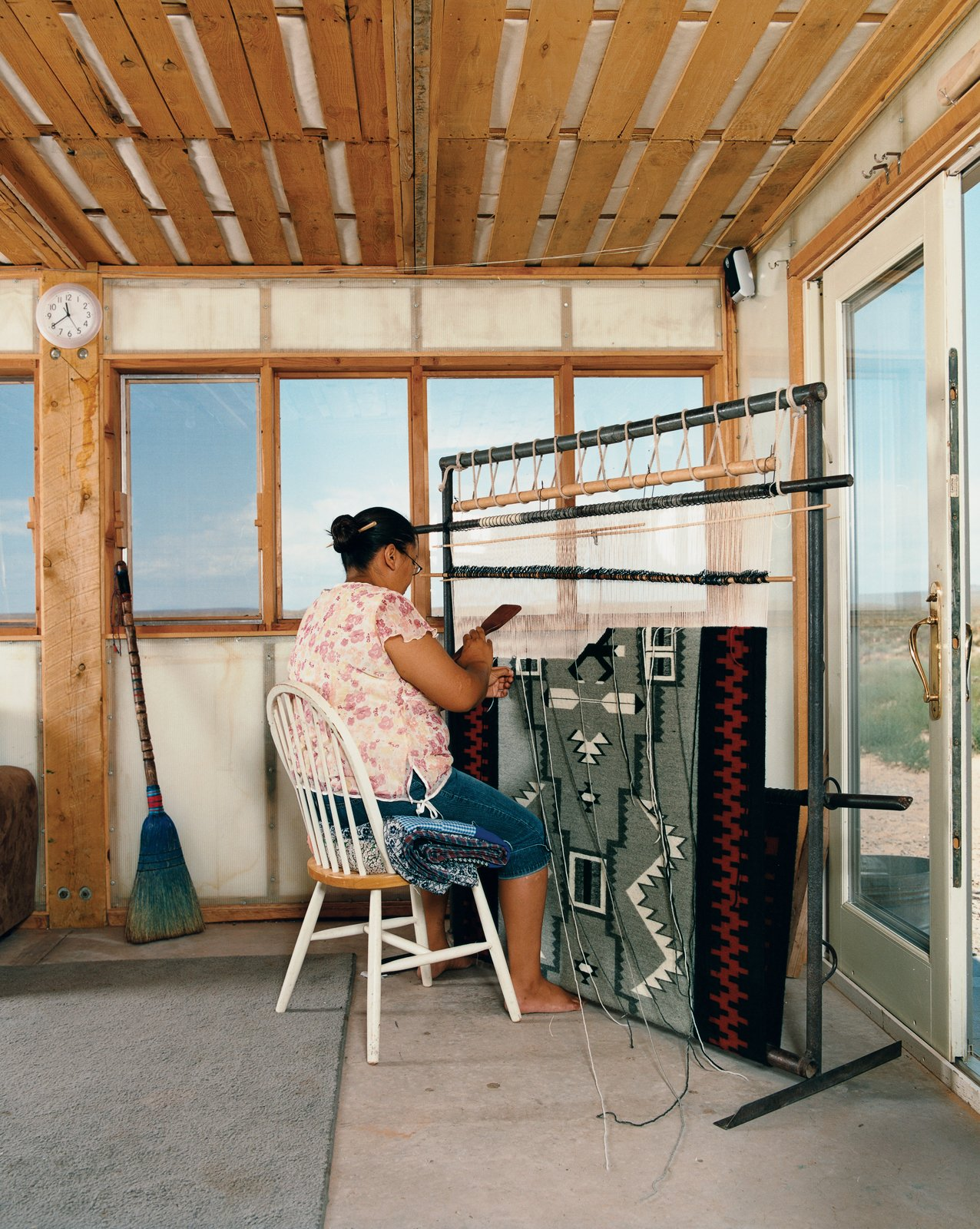Rosie Joe weaves a traditional Navajo rug.  Photo 5 of 8 in No Grid in Sight