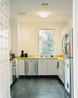 The kitchen is IKEA; the floors, like those in the bathroom, are Brazilian slate.