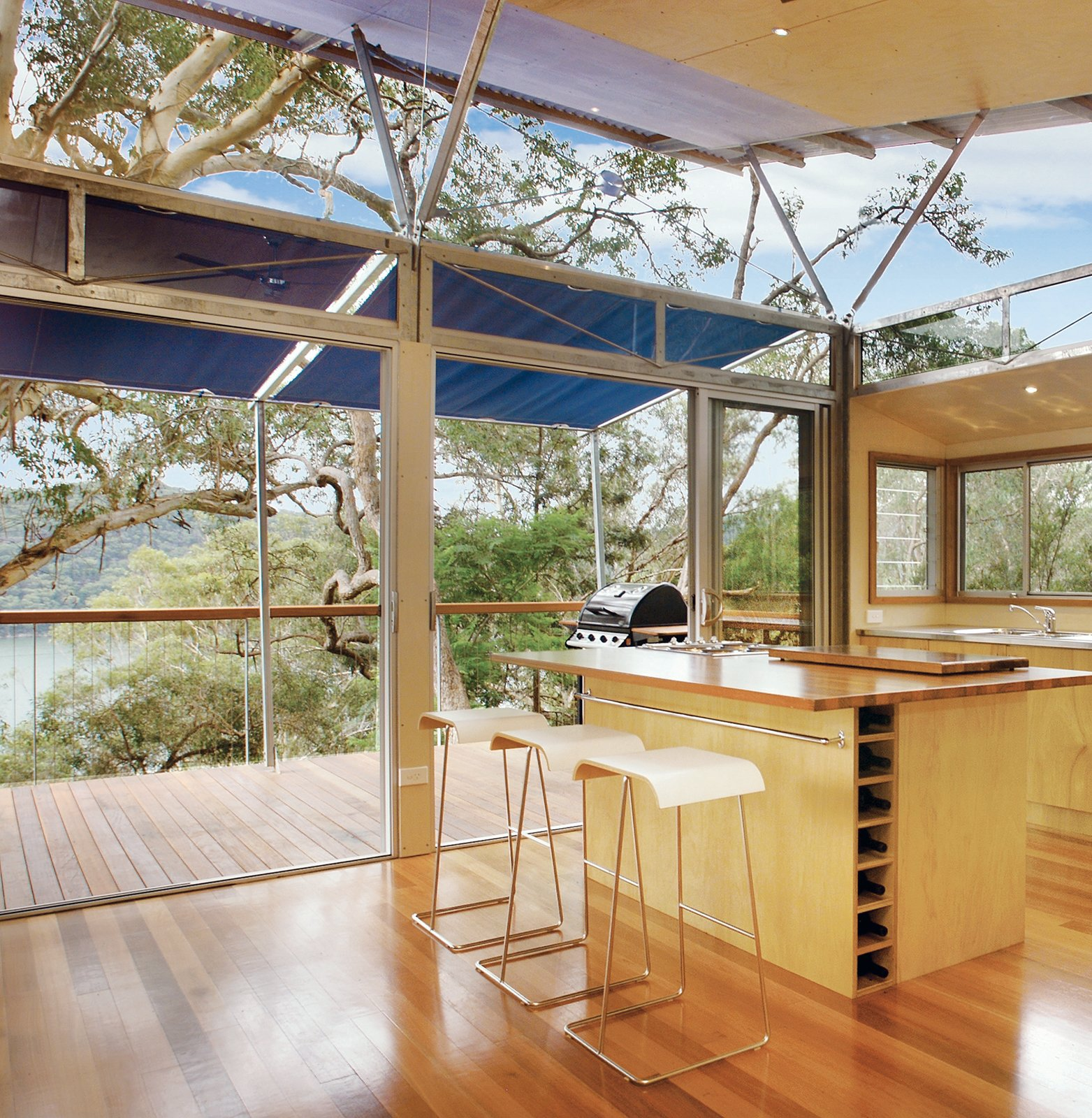 "The kitchen has a view to the Hawkesbury River.  Search ""glass house australia's sunshine coast"" from Outback Staked House"