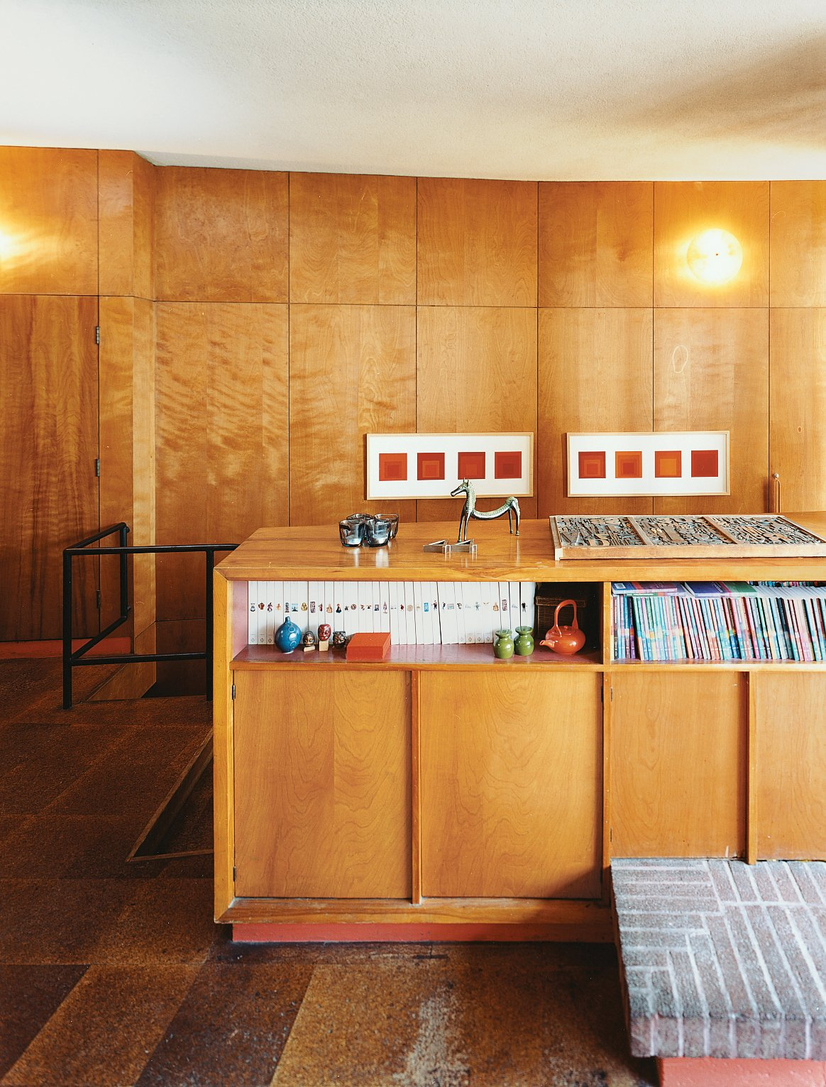Storage Room and Shelves Storage Type Tidy shelving provides perfect storage for Phaidon's Art and Ideas series. Joseph Albers prints hang in the background.  Photo 7 of 14 in Midcentury Mash-Up