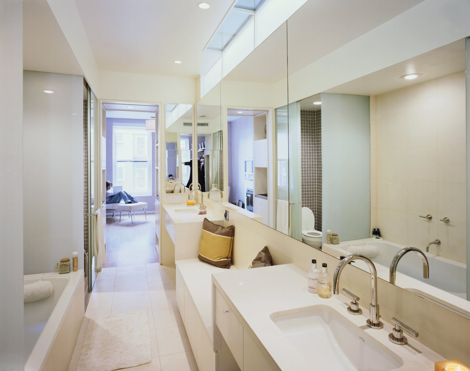 Bath Room, Undermount Sink, and Alcove Tub Martin's master bathroom, outfitted with a tub tricked out with jets and chromatherapy lights, allows her to soak in the luxury of her own home.  Photo 3 of 7 in Modern Rowhouse Renovation in New York