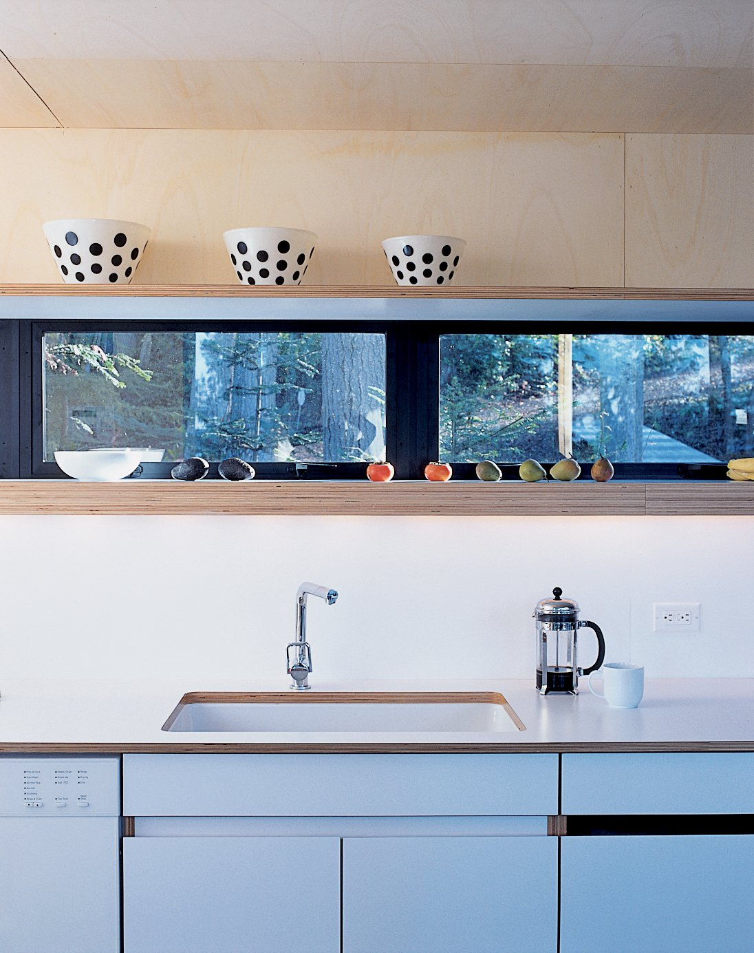 "Kitchen, White Cabinet, Undermount Sink, Wood Cabinet, and Open Cabinet The ""bar"" area houses all of the service sections like the kitchen, bathrooms, and laundry room.  Photo 4 of 4 in Washington State Vacation Home Sets the Stage"