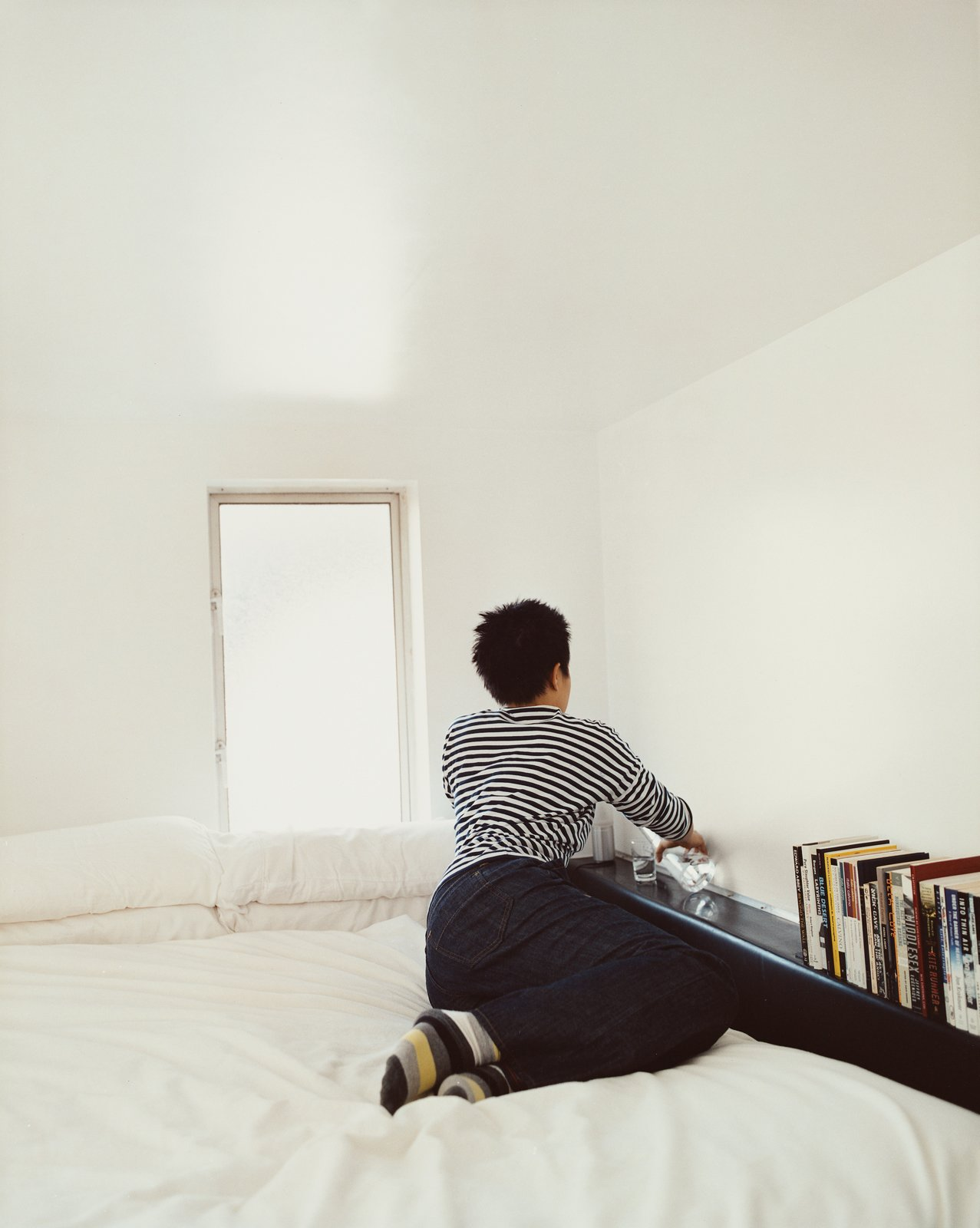 """Bedroom and Bed The Schafers consider their loft a work in progress. Says Im: """"We thought about building a library ladder for the Wall of Storage, and we'd planned to build a catwalk out from our sleeping loft, with a desk—but decided it was too much structural engineering to concern ourselves with at this point.""""  Photo 1 of 11 in Modern Mixed Use in San Diego"""