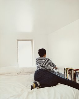 """The Schafers consider their loft a work in progress. Says Im: """"We thought about building a library ladder for the Wall of Storage, and we'd planned to build a catwalk out from our sleeping loft, with a desk—but decided it was too much structural engineering to concern ourselves with at this point."""""""