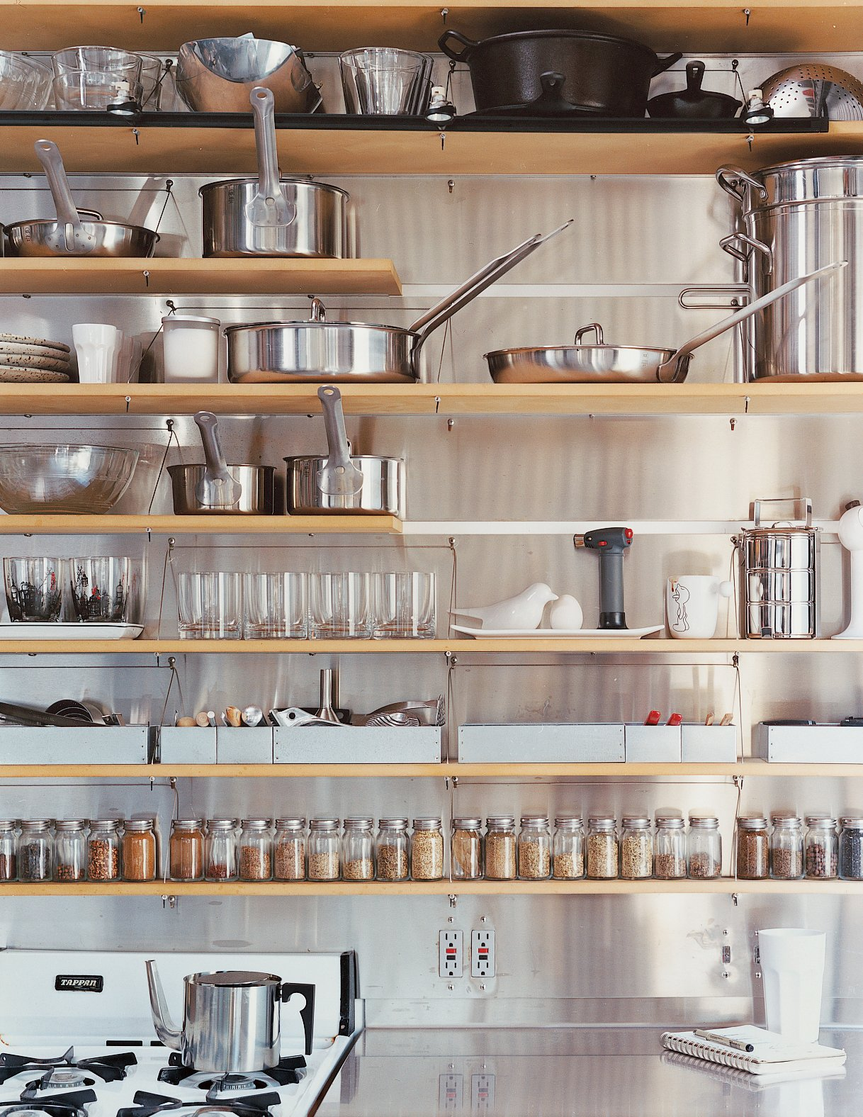 Kitchen The kitchen shelves are organized with clinical precision.  Photos from Modern Mixed Use in San Diego