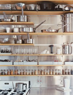 The kitchen shelves are organized with clinical precision.