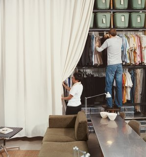 "Local sailboat shops wanted thousands to make the 13-by-13-foot curtain that hides the Wall of Storage. ""We we called my parents in Bangkok, gave them the dimensions, and they got it made for 150 bucks."" says Im."