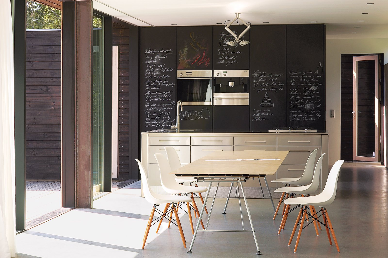 Kitchen and Wall Oven Chalkboard-fronted cabinets provide an ideal surface for scrawling shopping lists.  Best Photos from We Summer in the Hamptons