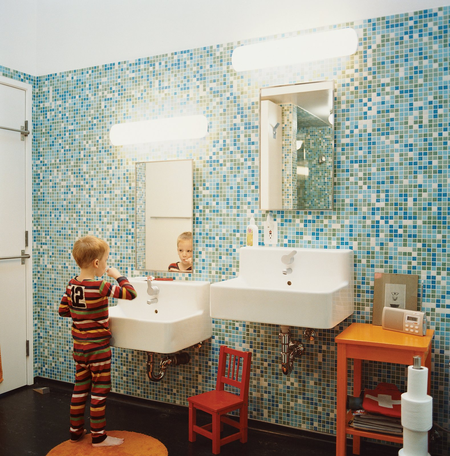 Bath Room, Wall Mount Sink, and Ceramic Tile Wall In the tiled master bathroom, the boys get their own sink.  50+ Modern Tile Ideas for Walls, Floors and Ceilings by William Lamb from Sun Mun Way Cool