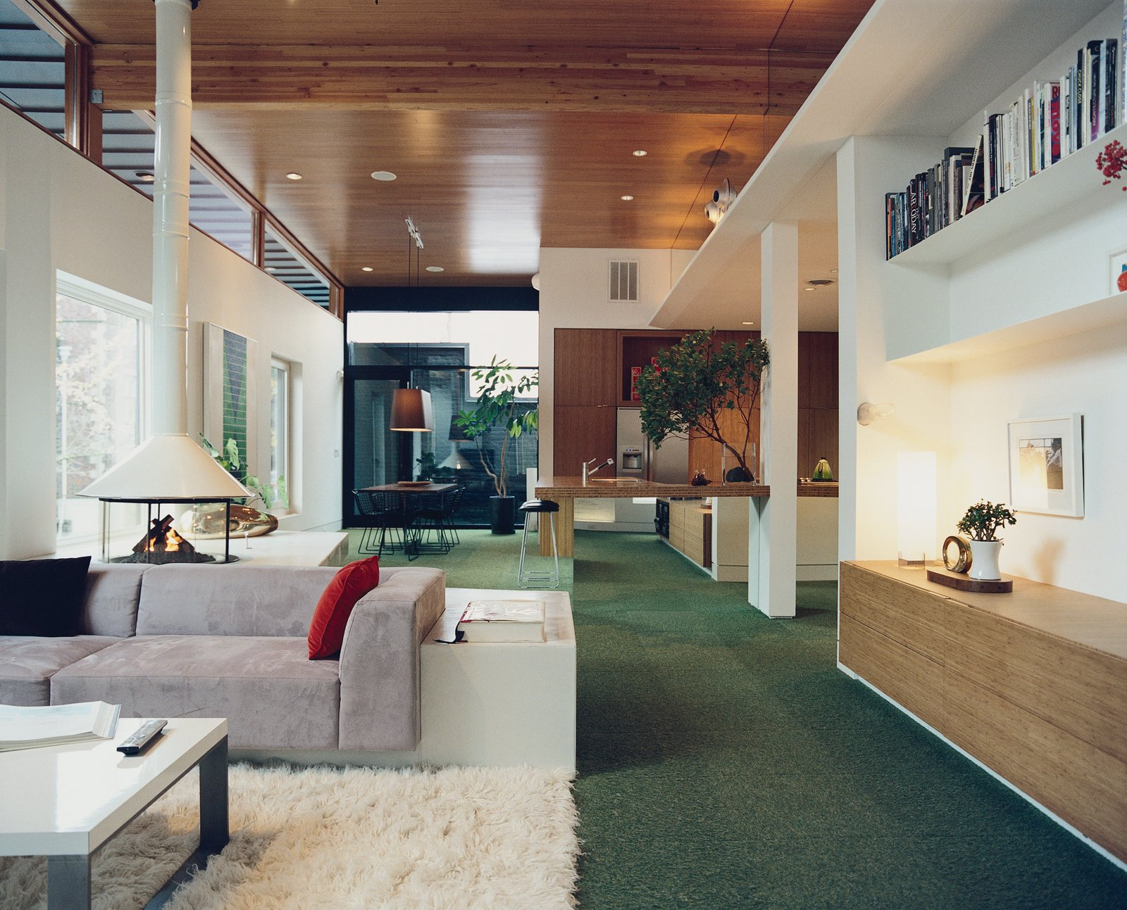 "Living, Rug, Ceiling, Recessed, Coffee Tables, and Sofa In lieu of a checkerboard effect, Kovel kept his carpet squares all vibrantly verdant. With the bamboo cabinets and countertops the whole space has a pastoral feel. ""I wanted it to be like the Bradys' backyard,"" he says.  Best Living Recessed Photos from WestEnders"