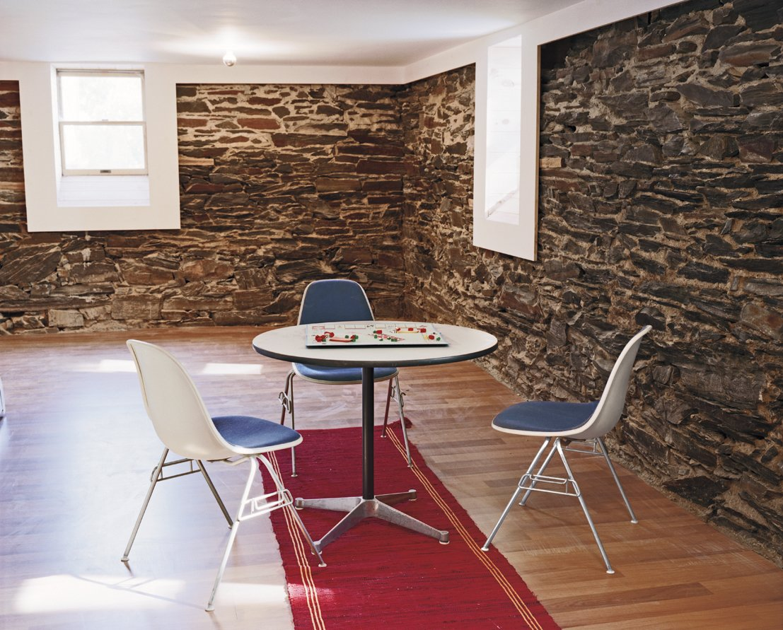 Schenk discovered native flagstone in the basement of Large when they tore away the old wood wall lining, and fell in love with its rough and cool exterior.  Photo 5 of 11 in Four Houses and a Future