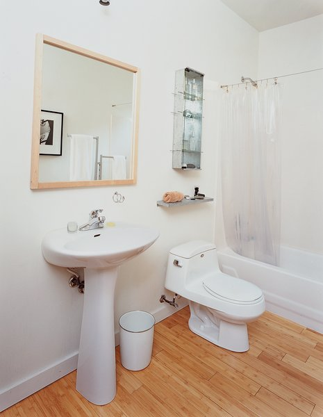 The family opted for modest—and cheap—design choices in the kitchen and bathroom (above), which are commonly the most money-sucking rooms in a home.  Photo 10 of 13 in Baton Rouge Oasis